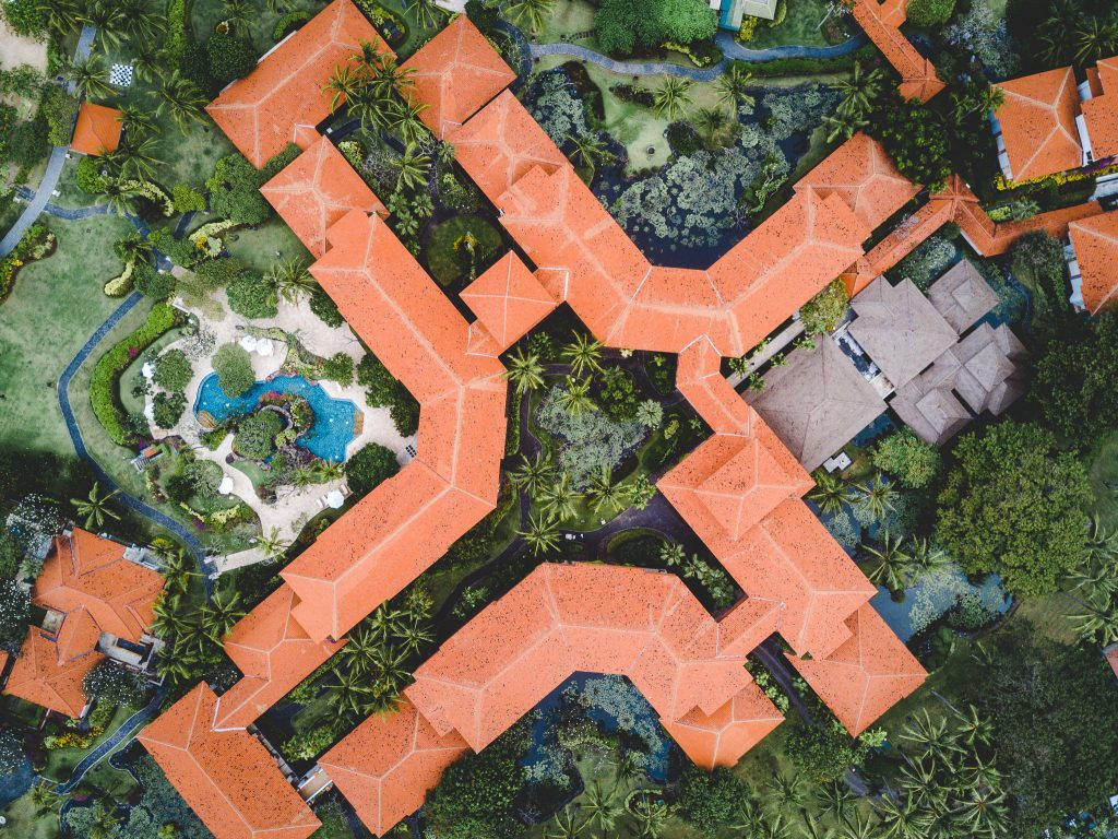 Aerial view of bright terracotta roof of a tropical resort building