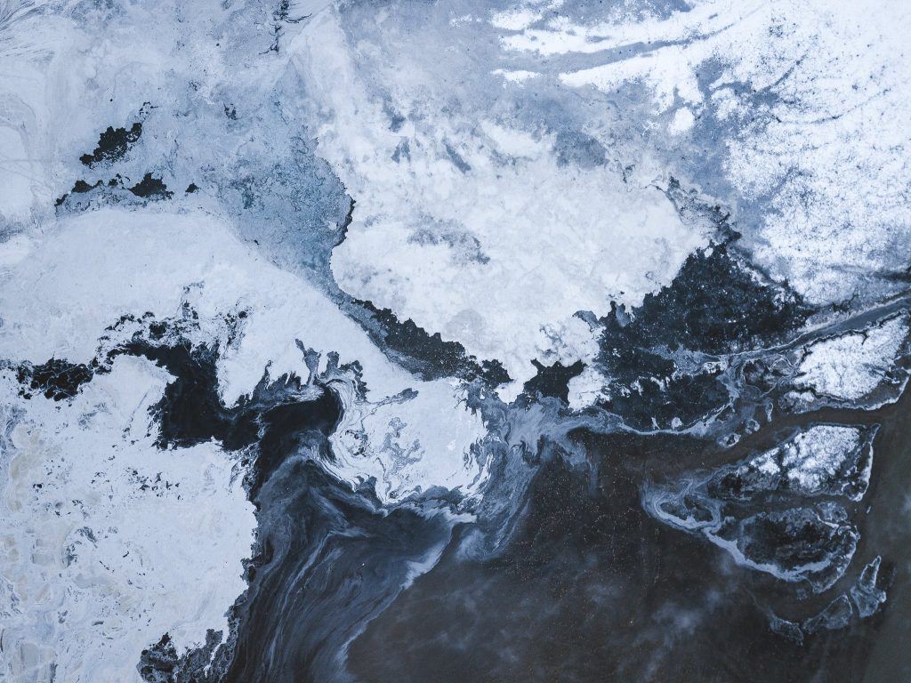 Aerial view a frozen ash slurry in a storage lake in winter