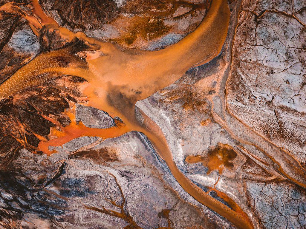 Aerial view of orange coal ash slurry