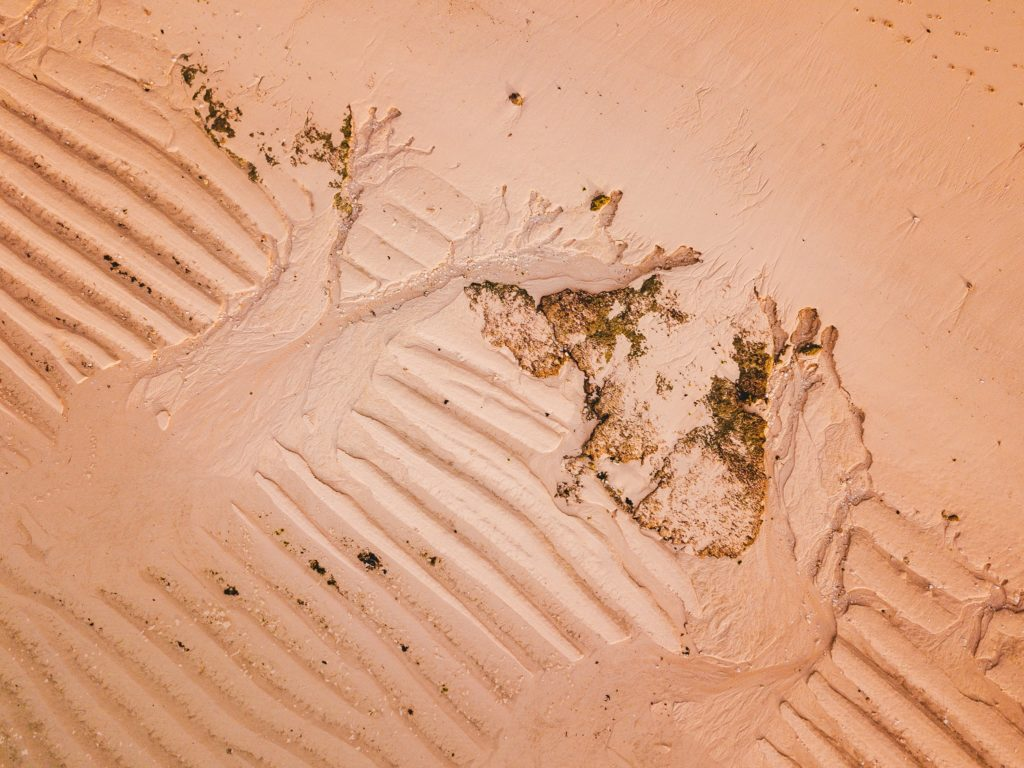 Aerial view of pattern in the sand on the beach