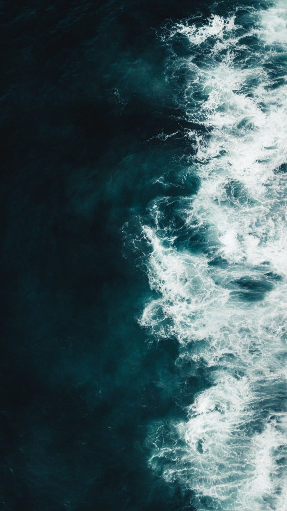 Aerial view of a turquoise wave