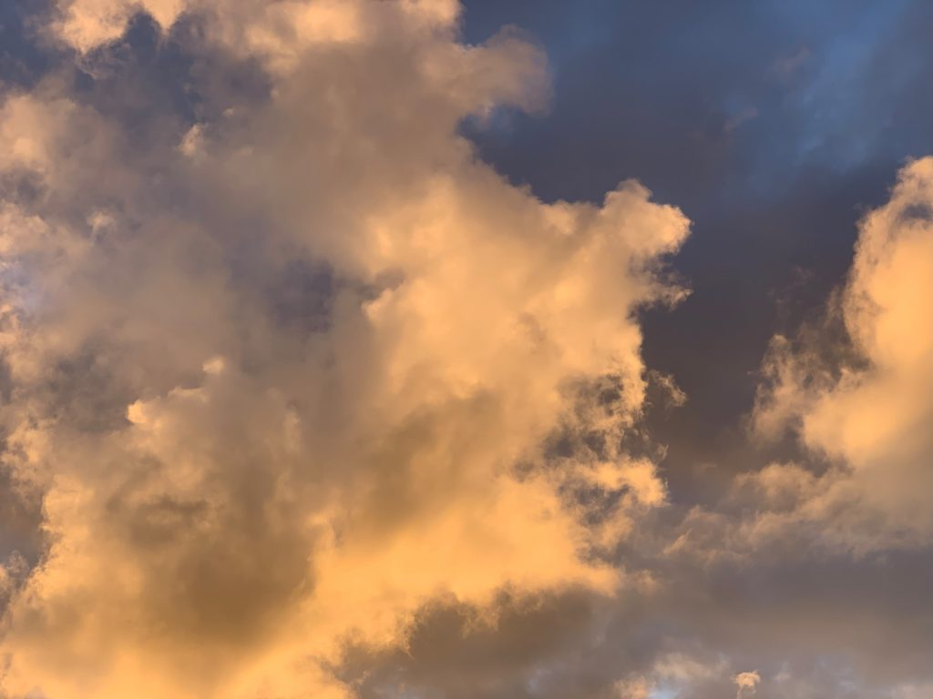 Clouds in the orange sky just before sunset
